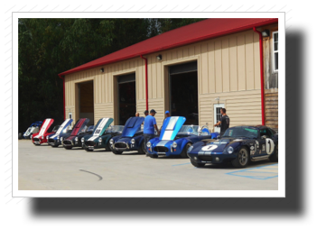 A beautiful string  of Cobras lead by John Volbers' Superformance Daytona Coupe.